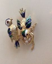 Gold and enamel brooch with small pearls.