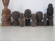 Carved heads in wood