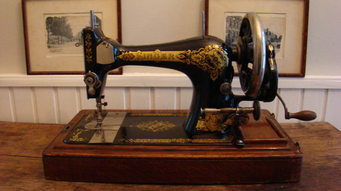 Singer 38 sewing machine with wooden dust cover and key, 1909.