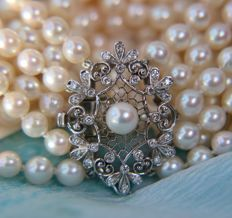 "Exquisite five-strand necklace with genuine Japanese sea/salt AAA Akoya pearls set with 18Kt. white gold large ""LOTOS"" clasp full of small quality G/VVS Diamonds. Excellent condition."