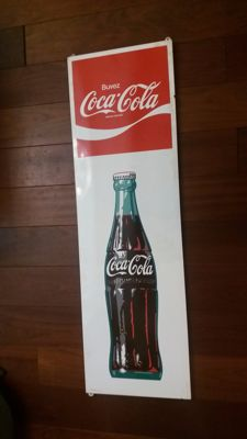 Oblong Coca Cola advertising sign