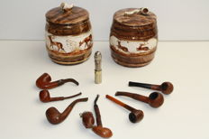 Two tobacco jars decorated with hunting scenes with seven pipes and a match holder - foreign legion