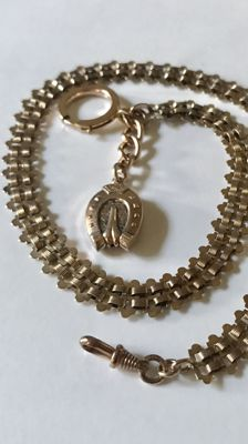 Antique rose gold coloured watch chain / chateleine with horseshoe pendant, around 1900