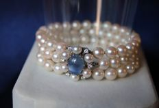 Luxury three strand bracelet with sea/salty Japanese Akoya quality pearls with a white gold clasp set with a Sapphire cabochon of approx 1.50 ct and 7 H/VS1 Diamonds for a total of 0.36ct.
