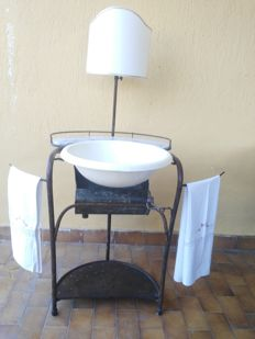 Antique wrought iron washbasin with washbowl, tub to collect the waste water, marble soap dish, two folding towel racks and a lamp with fabric shade of a later time - France - mid 19th century