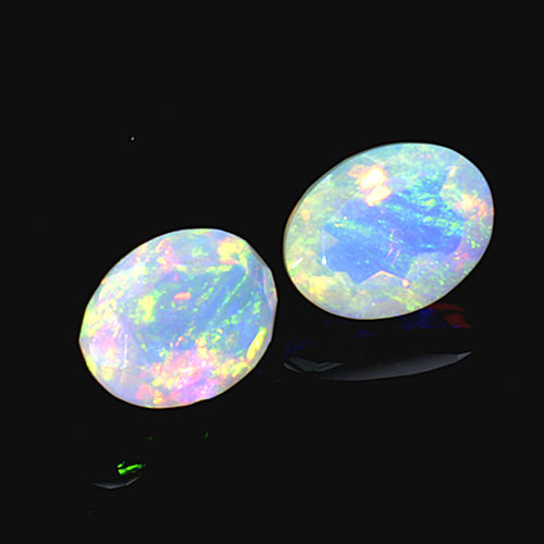 2 opals - 1.53 ct in total (0.74 ct + 0.79 ct) - No reserve price