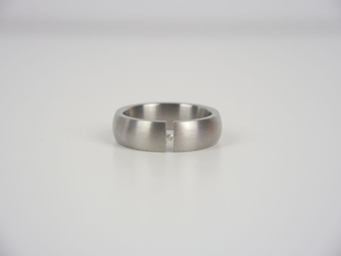 Titanium women's clamp ring with a 0.02 ct brilliant. Ring size 54 / 17 mm