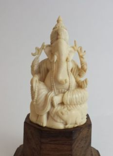 Ivory carving of Ganesha on a rose wood stand - East India - 19th century