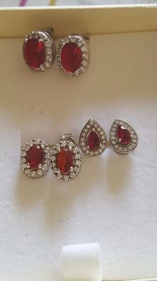 Lot of 925/1000 silver earrings with red sapphires and brilliant cut white accent sapphires.