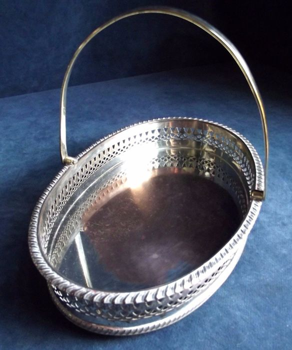 Nice silver plated oval basket with pierced decoration and handle, c. 1890