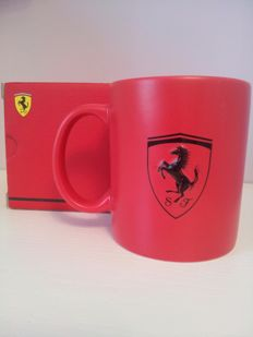 Ferrari red mug with Ferrari prancing horse plushy and Ferrari World Champions 2003 pin