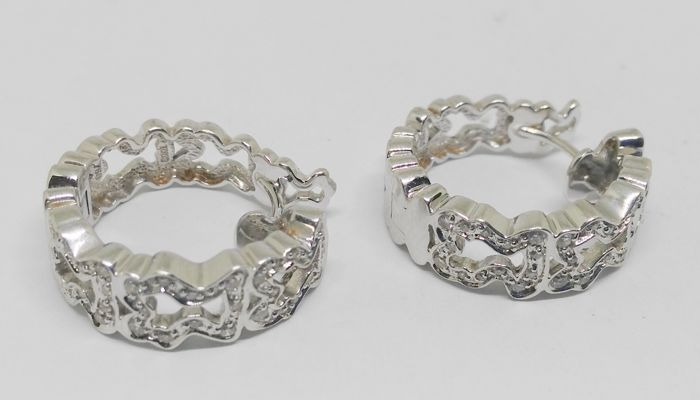 earrings in 18 kt white gold with 72 diamonds