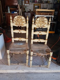 A pair of lacquered and gilt chairs - Italy, early 20th century