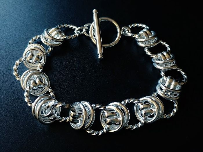 Bracelet in 925 silver of 20 cm in length with alternating smooth and curved links