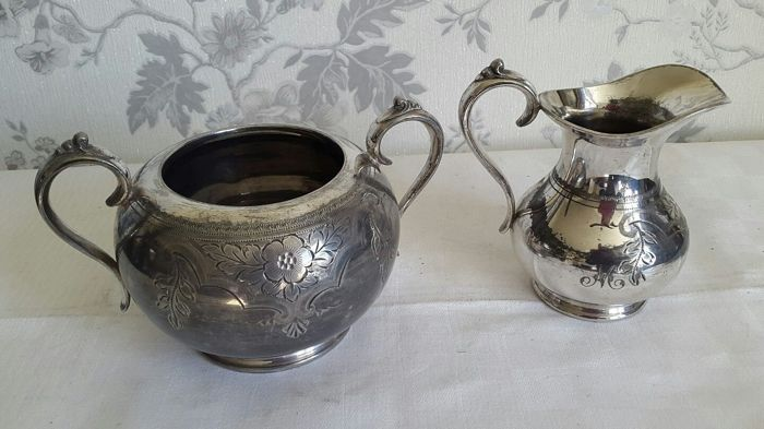 Silver plated Milk Jug and Sugar Bowl, with floral decoration