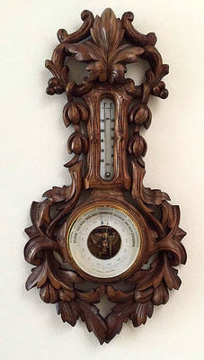 A wooden richly carved barometer with thermometer - W.J. Lauwers, Amsterdam, Netherlands, ca. 1900