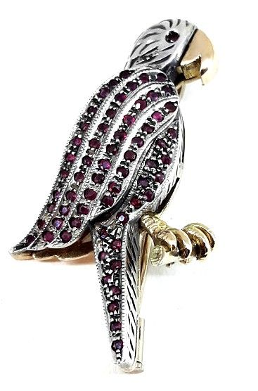 Women's brooch with rubies in 18 ct white and yellow gold