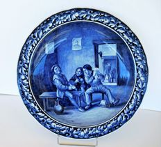 A large wall platter VILLEROY & BOCH, METTLACH, Made in Saar-Basin - Germany - around 1900.