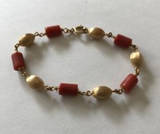 Gold and coral bracelet