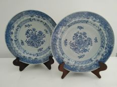 Blue and white porcelain plates decorated with flowers – China – 18th century