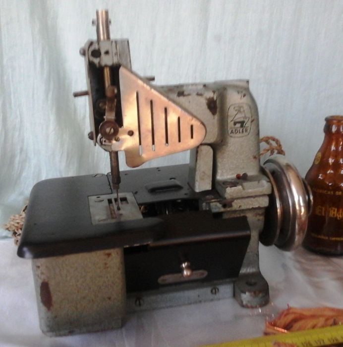 Old sewing machine branded ZELLWEGER.