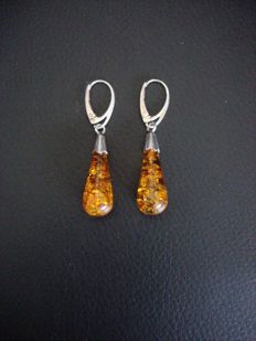 Vintage, silver, long earrings set with amber droplets.