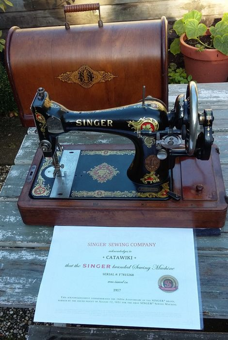 A decorative Singer 128K manual sewing machine with the original wooden cover, Scotland, 1917