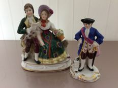 Two Chelsea toys - Porcelain bunch of sitting on a rock and soldier with dog