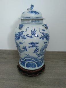 Blue and white porcelain vase decorated with two dragons playing with a ball – China – 19th century
