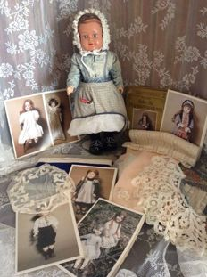Lovely celluloid doll together with beautiful pieces of antique lace, band and different colours fabric, along with nostalgic patterns to make doll dresses - around 1900 and 1940