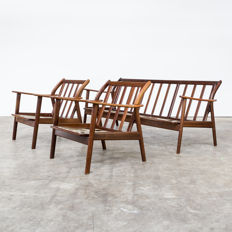 Designer unknown – mid-century modern rosewood seats consisting of two armchairs and a sofa (without upholstery)