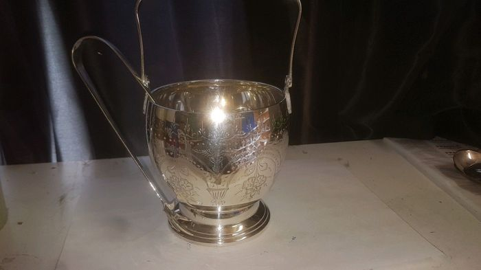 Excellent silver plated ice bucket, finely decorated with clawed tongs