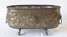 Brass jardiniere decorated with grape vines and lion heads - original zinc inner tray