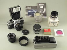 Canon AE-1 camera with a large collection of Canon accessories.