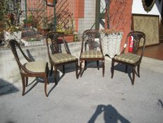 Four chairs with seat upholstered in fabric and backrest with pierced splat