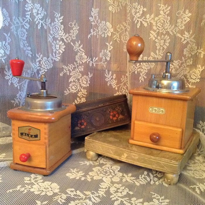 Two antique marked coffee grinders and an antique coffee and tea tin
