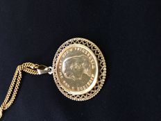 Gold necklace with a gold tenner (10-guilder-coin) in a pendant.