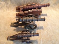 Vintage, three cannons of various types and periods in bronze and wood