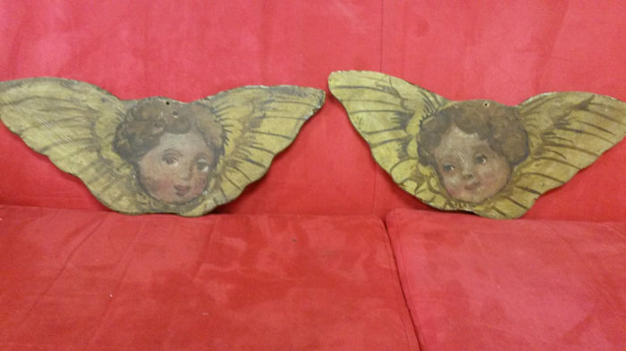 Two small oil paintings on wood, late 19th century, depicting two winged cherubs