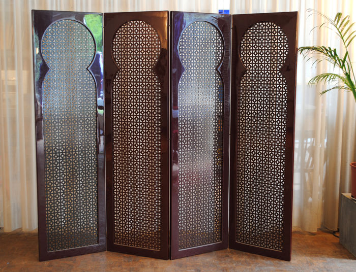 Four-part folding screen, hand polished, 'sang de boeuffe', 2nd half 20th century.