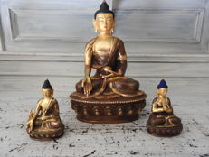 Three fire-gilded bronze Buddha figurines - Nepal - second half 20th century