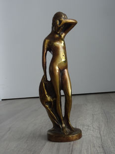 Bronze sculpture of a naked girl
