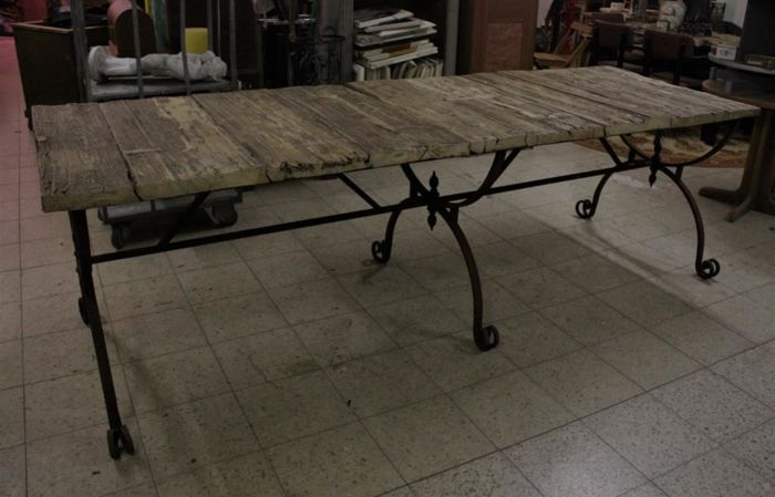 Large 8/10 people table with heavy boards, the wood is hundred years old, wrought iron frame