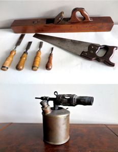 Antique hand tools: copper paint sprayer, large plane, saw and 4 chisels