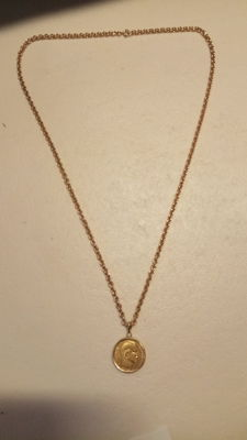 Chain and pendant in 18 kt gold.
