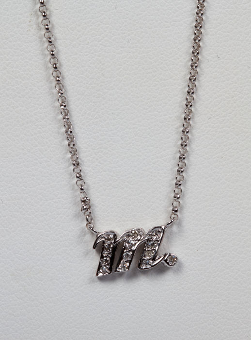 "Necklace and pendant in the shape of an ""M"" in white gold with 0.10 ct diamonds - Pendant: 10 x 5 mm"