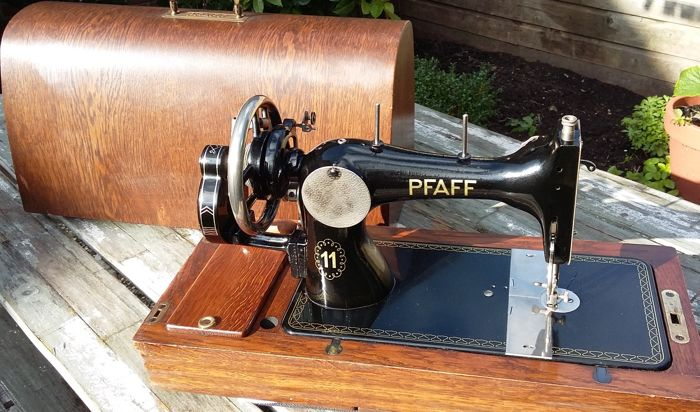 A decent manual Pfaff sewing machine with wooden cover, Germany. 2nd half of the 20th century