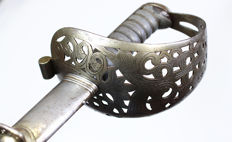 Unknown large cavalry sword with decorated blade in scabbard