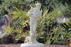 Large alabaster statue of a woman with a dog on an onyx base