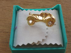 Lapel pin in 18 kt gold with stones